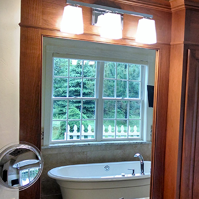 Photo of a residential window over a white bath tub
